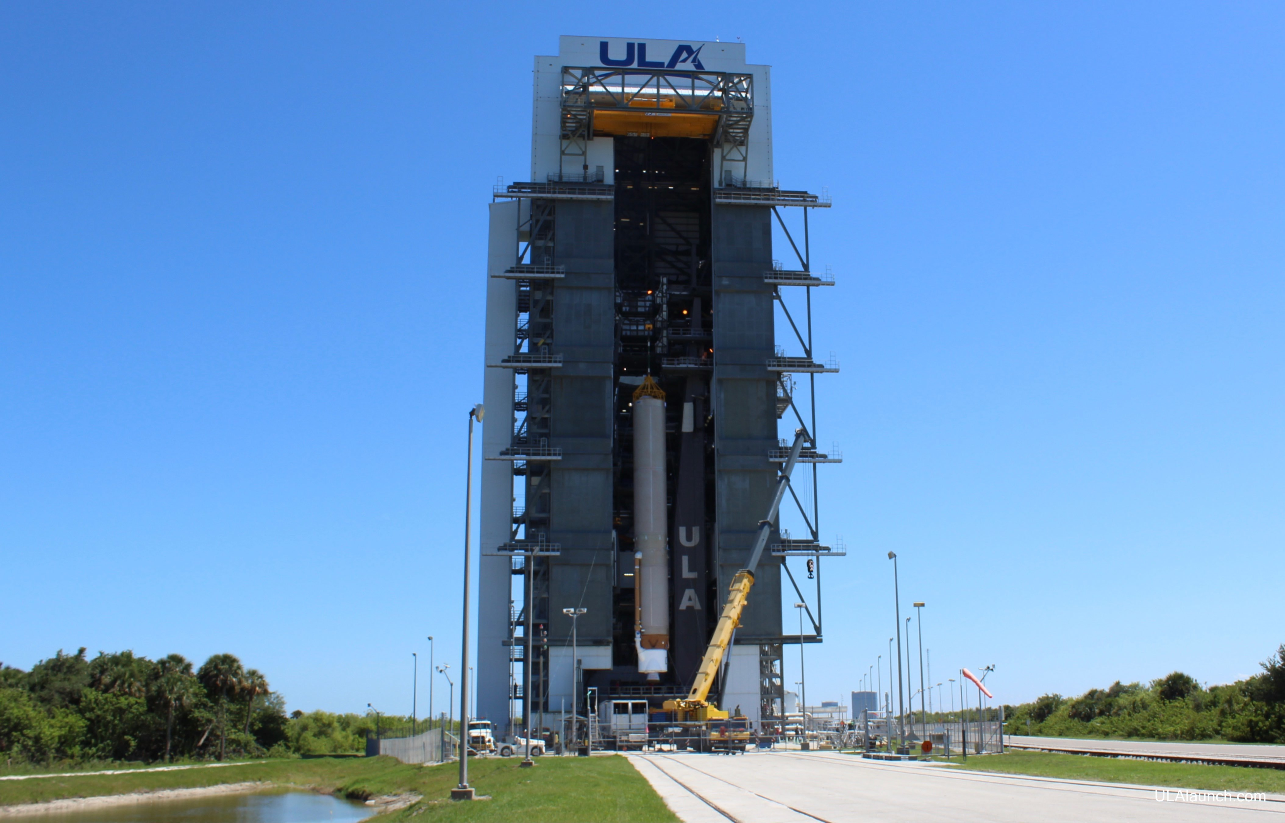 The first stage to launch AEHF-5 is hoisted onto the MLP. Photo: United Launch Alliance