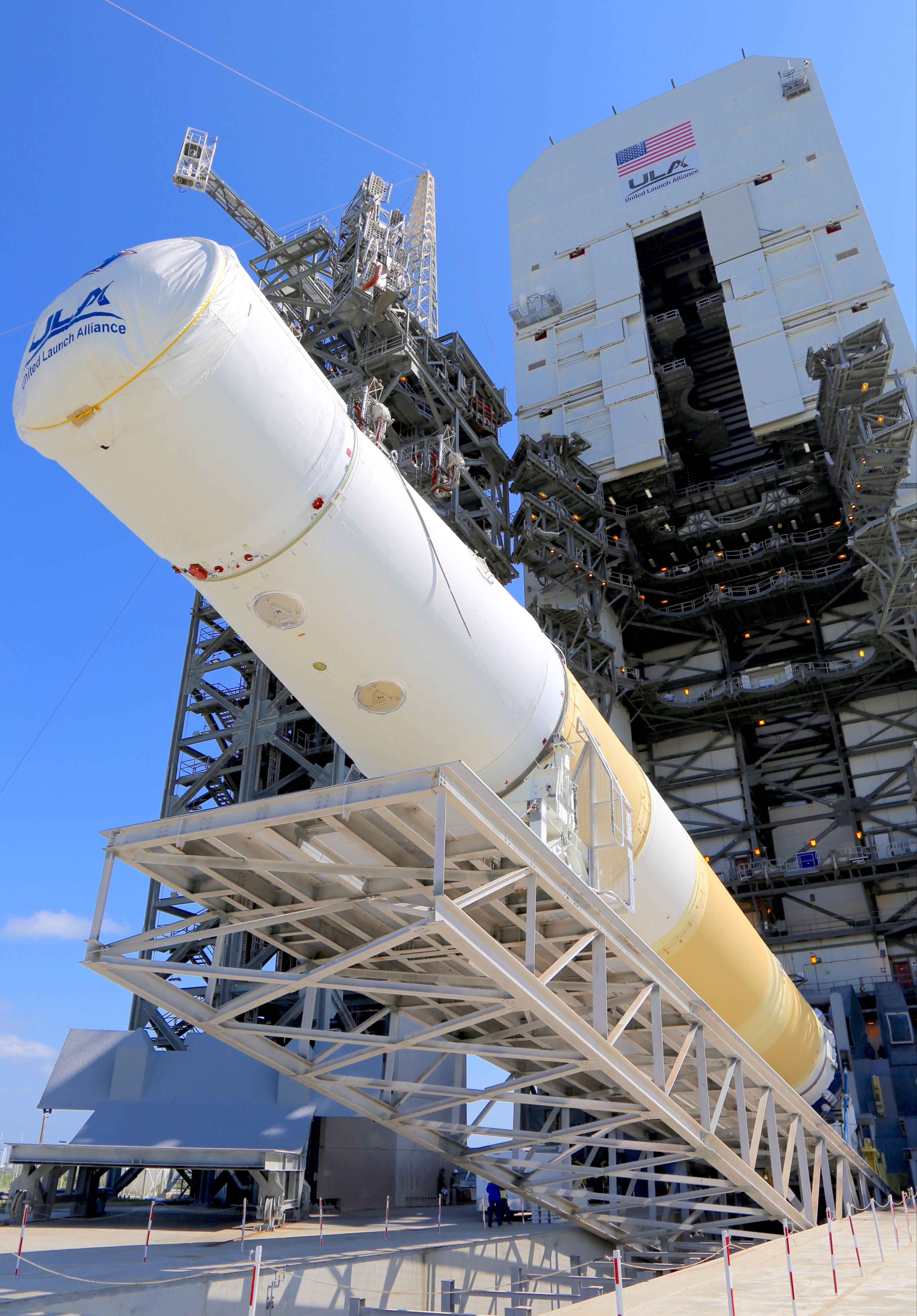 The fixed pad erector lifts the Delta IV upright. Photo by United Launch Alliance