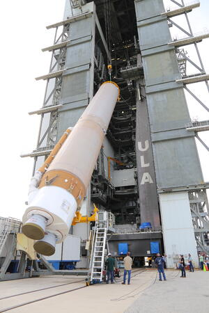 The OFT booster is lifted into position for stacking at the ULA Vertical Integration Facility.