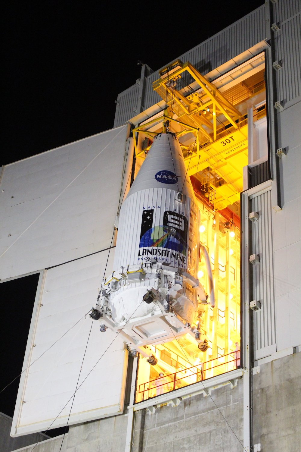 The encapsulated Landsat 9 spacecraft departs the Integrated Processing Facility (IPF). Photo by United Launch Alliance