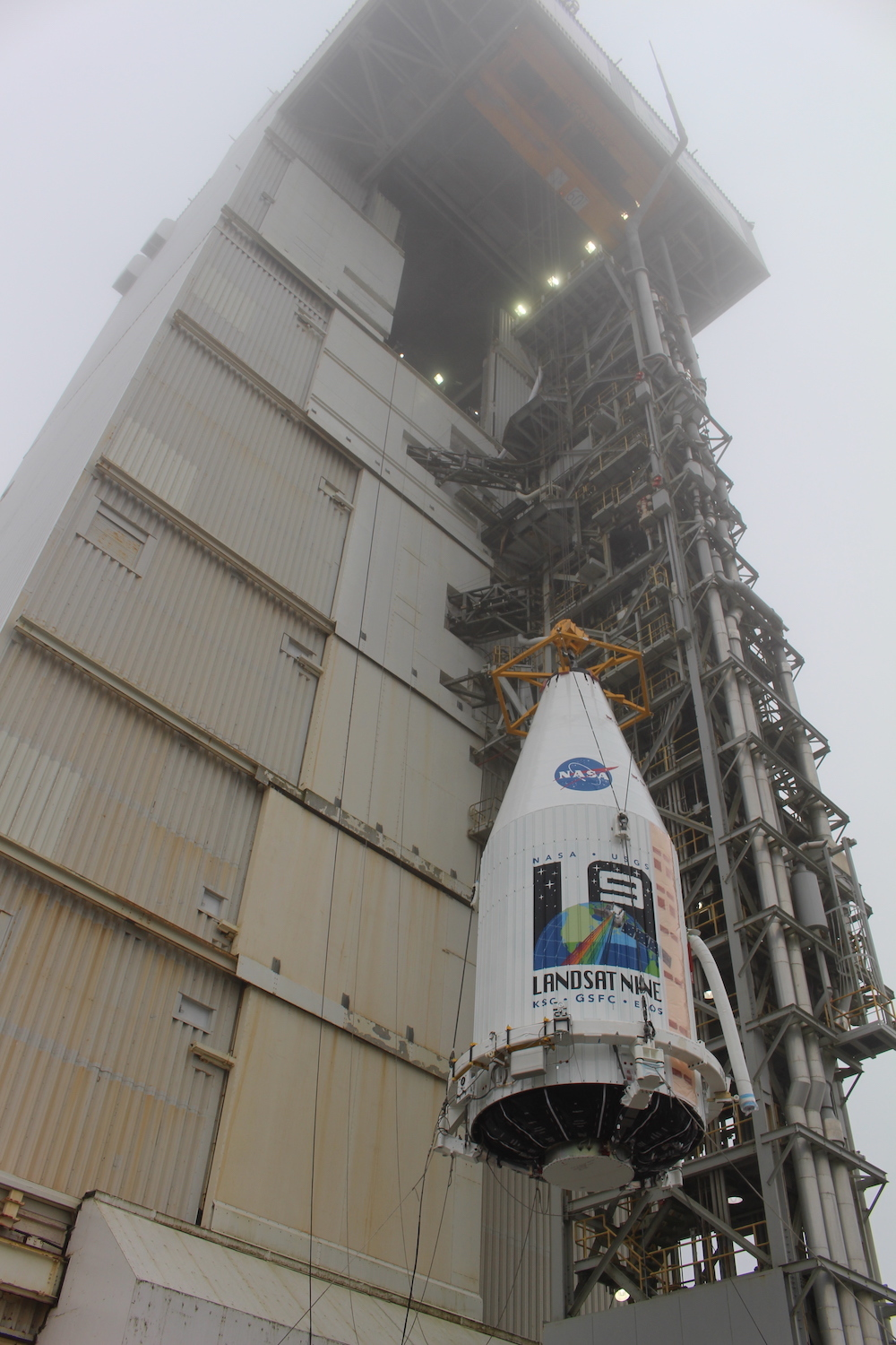 The encapsulated Landsat 9 is hoisted aboard the Atlas V at SLC-3. Photo by United Launch Alliance