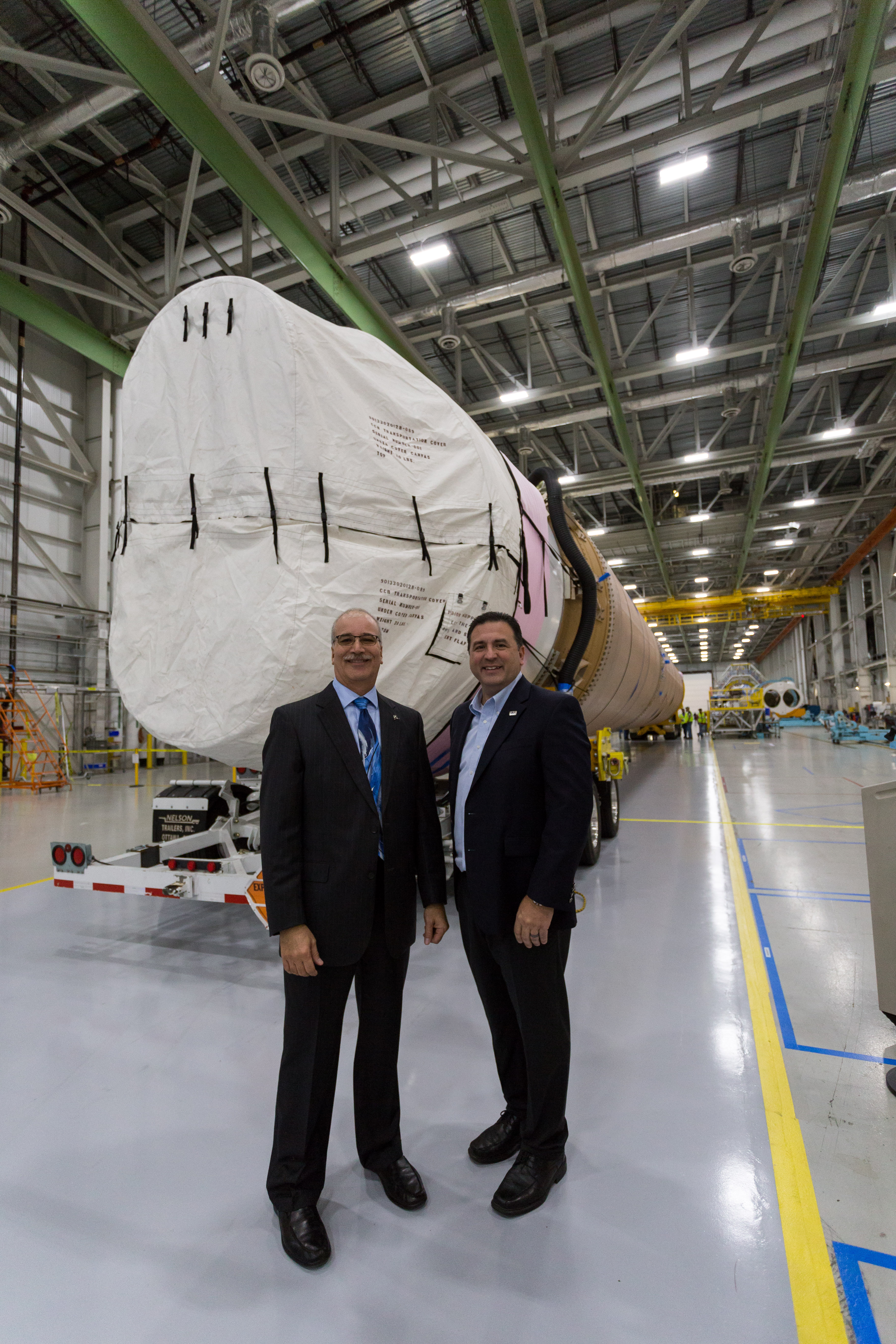 Boeing's Rick Navarro and ULA's Gary Wentz addressed dignitaries and the news media in front of the CFT booster in the factory before rollout. Photo by ULA