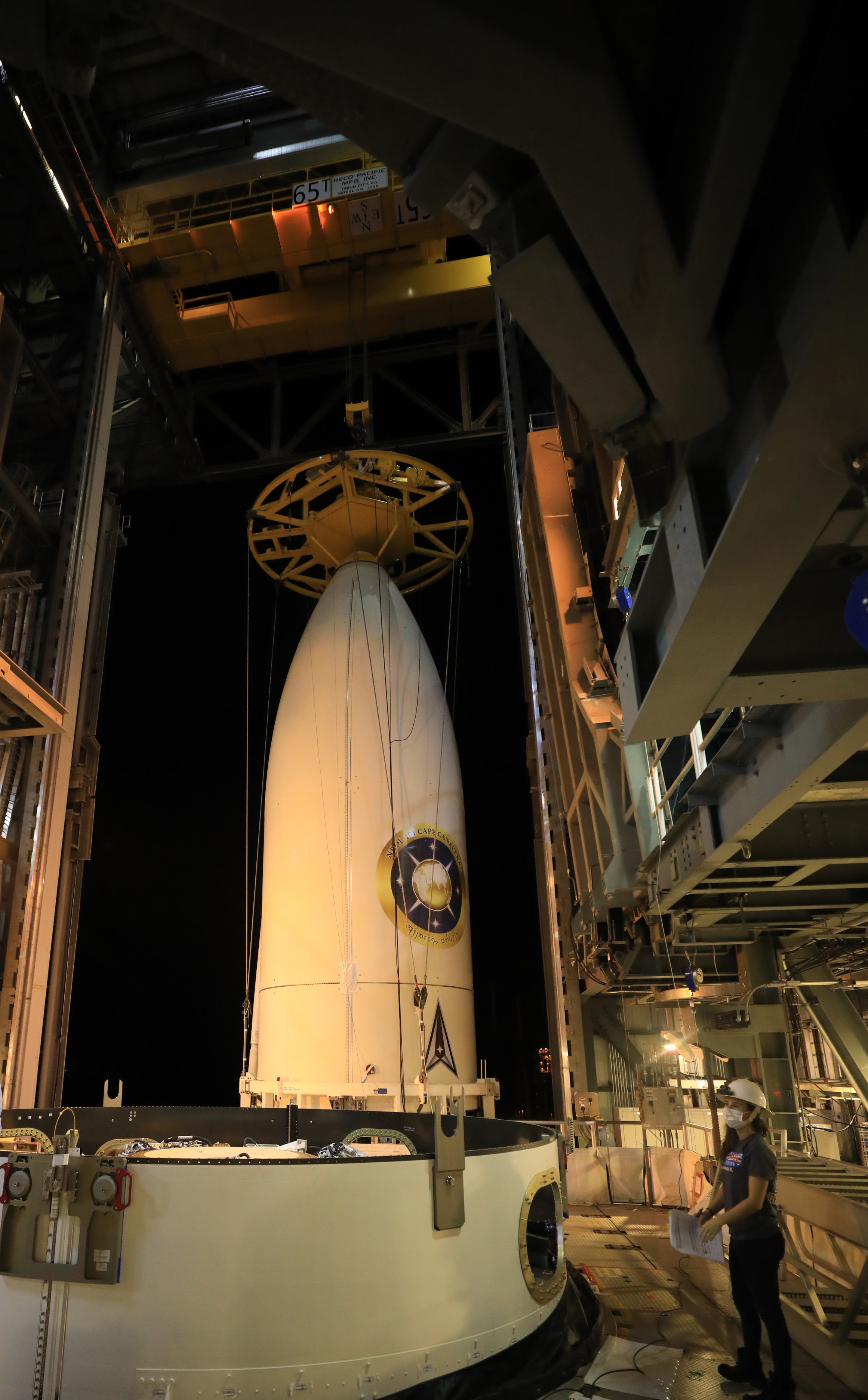 The encapsulated NROL-101 payload is hoisted into the Vertical Integration Facility for attachment to its Atlas V rocket. Photo by United Launch Alliance