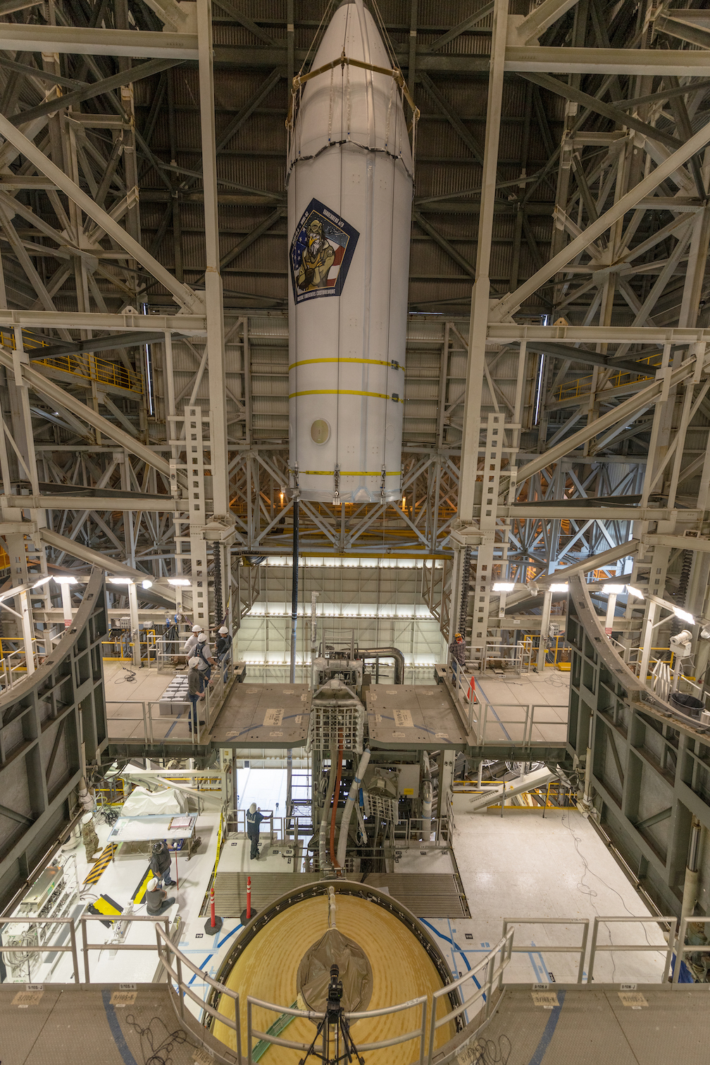 The NROL-82 payload is hoisted by crane to be mounted to the Delta IV Heavy rocket. Photo by United Launch Alliance
