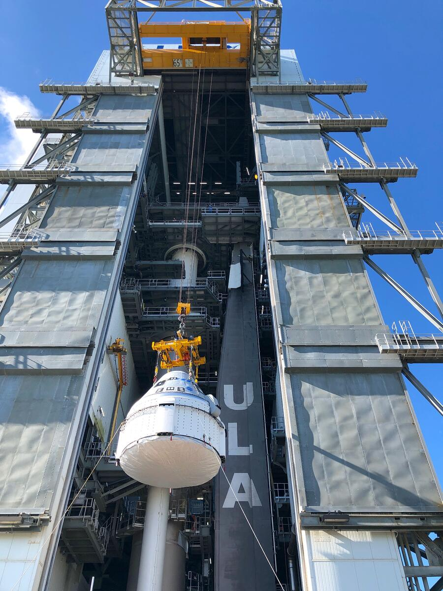 Starliner is hoisted atop the Atlas V for the Orbital Flight Test-2 for NASA's Commercial Crew Program. Photo by United Launch Alliance