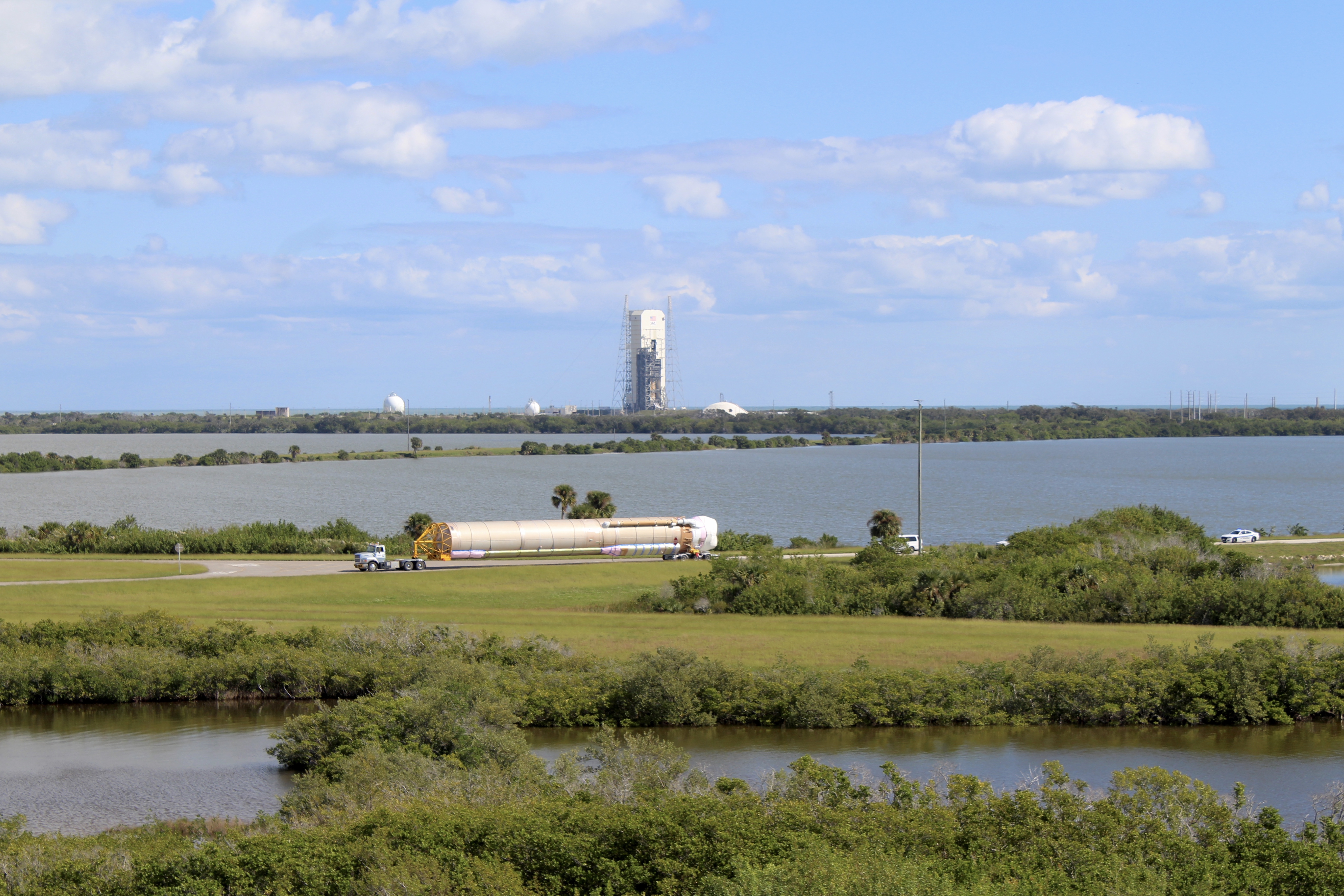 The Atlas V first stage is transported along the ITL Causeway. Photo by United Launch Alliance